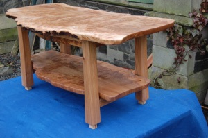 burr elm table with magazine shelf